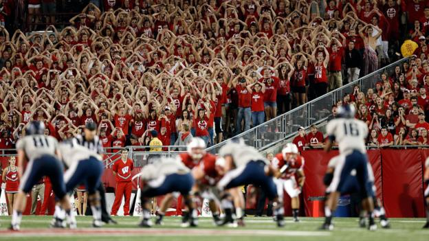 The Wisconsin Badgers play the Utah State Aggies (Credit: Tom Lynn/Getty)