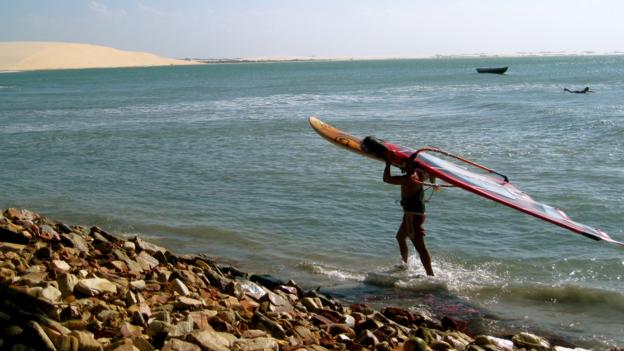 A windsurfer turns in for the day (Credit: Kiran Herbert)
