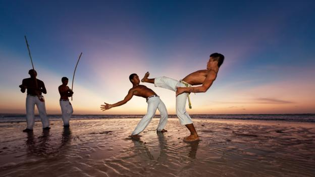 Capoeira on the beach (Credit: Craftvision/Getty)