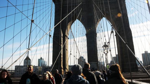 Walking over the Brooklyn Bridge (Credit: Desiree Navarro/Getty)