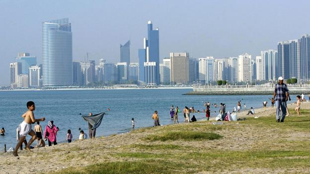 Residents enjoy a day at the beach along the Corniche (Credit: STR/AFP/Getty)