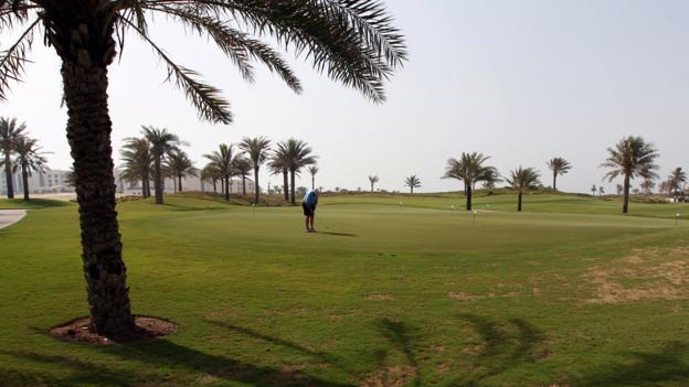 Playing golf on a course on Saadiyat Island (Credit: Marwan Naamani/AFP/Getty)