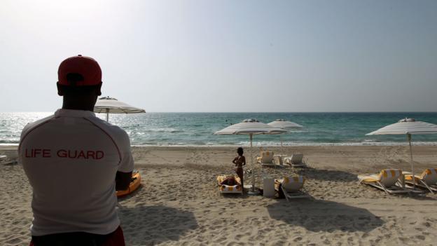 Sunbathing on Saadiyat Island (Credit: Marwan Naamani/AFP/Getty)