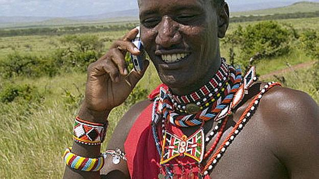 Massai tribesman talks on his cell phone in North Kenya, Africa (UIG/Getty)