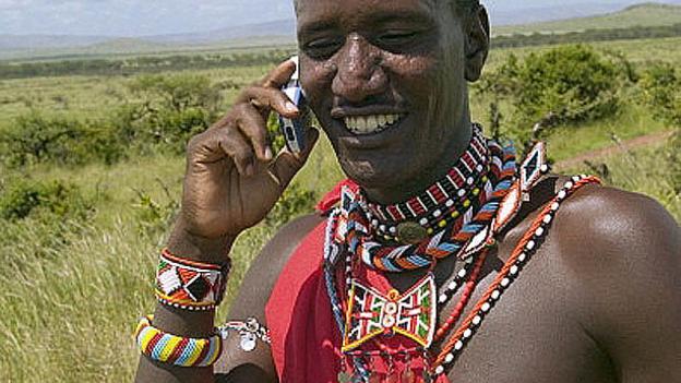 Massai tribesman talks on his cell phone in North Kenya, Africa (UIG/Getty)