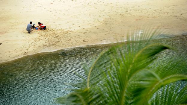 The Palawan Beach lagoon, Singapore (Credit: Roslan Rahman/AFP/Getty)