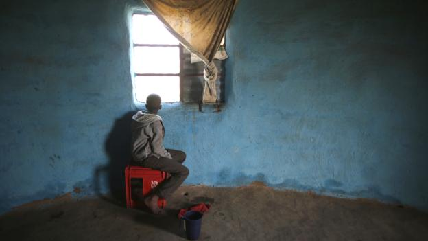 A boy watches the funeral from his window in Qunu (Credit: Getty Images)