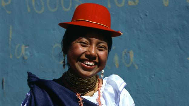 Otavalo woman wearing traditional dress (Credit: Per-Andre Hoffmann/Getty)