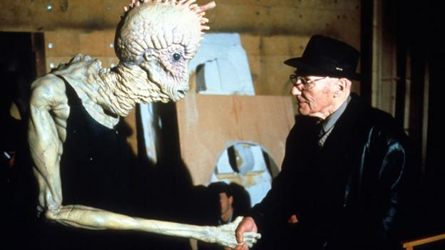 Burroughs with a Mugwump on the set of Naked Lunch in 1991. (Photos 12/Alamy)