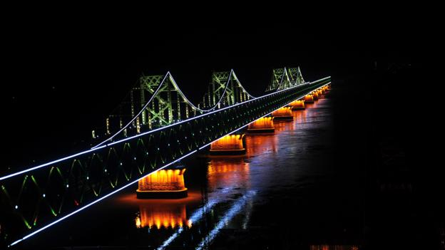 The broken Friendship Bridge extends toward North Korea (Credit: Frederic J Brown/AFP/Getty)
