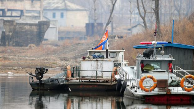 Deserted North Korean navy and police boats on the Yalu (Credit: Frederic J Brown/AFP/Getty)