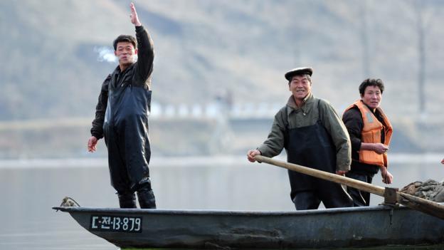 North Korean fishermen on the Yalu River (Credit: Frederic J Brown/AFP/Getty)