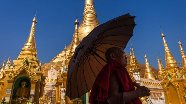 A Buddhist monk walks around Rangoon's Shwedagon Pagoda (Credit: Marjorie Lang/Getty)
