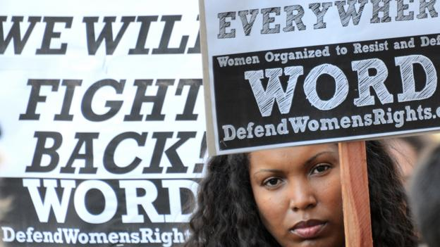 A demonstrator protests on International Women's Day in 2013. (Joe Klamar/AFP/Getty)