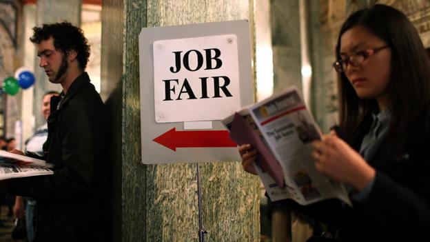 People looking for work browse vacancies at a US jobs fair (Getty Images)
