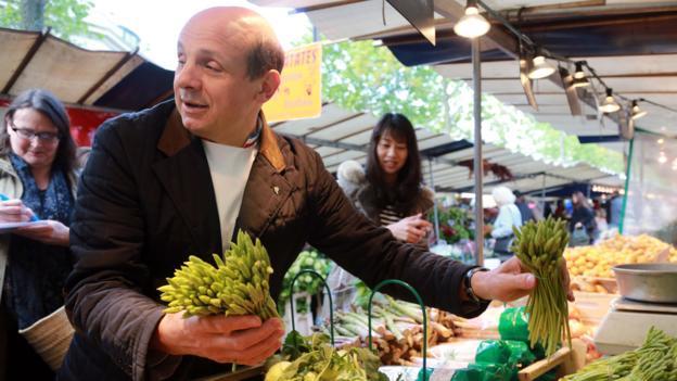 French chef Eric Briffard forages in a farmer's market (Credit: Pierre Verdy/AFP/Getty)