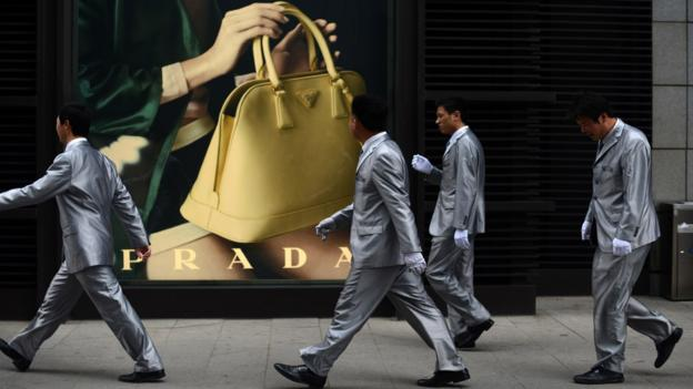 Wait for sales (Credit: Wang Zhao/AFP/Getty Images)