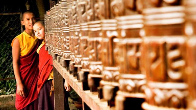 Peeking past prayer wheels (Credit: Yellow Street Photos/Getty)