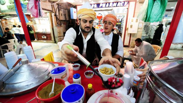 A trader in takeaway (Credit: Omar Salem/AFP/Getty)