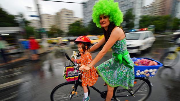 Bicycling in Bucharest (Credit: Daniel Mihailescu/AFP/Getty)