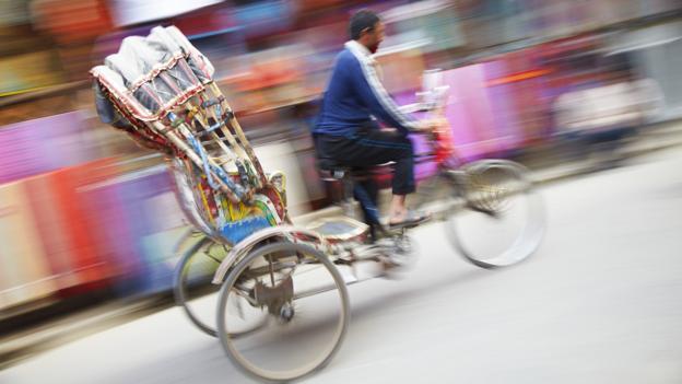 Cheap transport by rickshaw (Credit: Ian Trower/Getty)