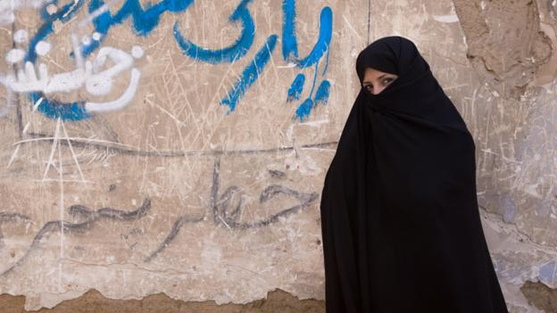 A woman wearing a traditional black Persian chador, Yazd (Credit: Guido Dingemans, De Eindredactie/Getty)