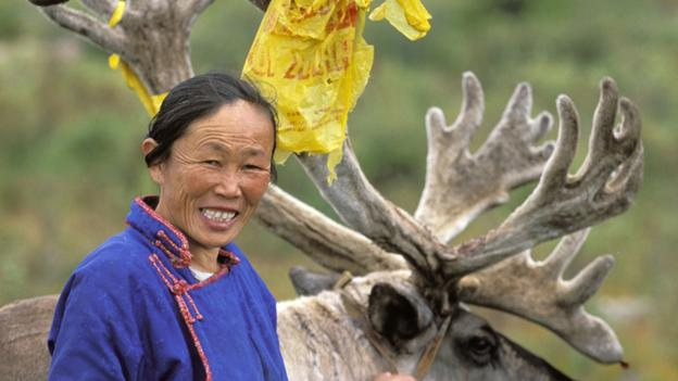 Tsaatan woman and reindeer (Credit: Christophe Boisvieux/Getty)