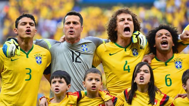 Brazil's team sing the National Anthem