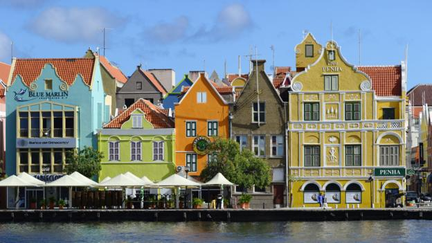 People in Curaçao are as diverse as their waterfront buildings. (Hughes Herve/Getty)