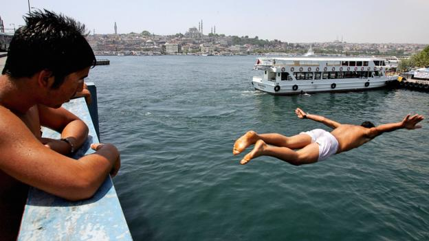 Leaping into the Golden Horn (Credit: Mustafa Ozer/AFP/Getty)