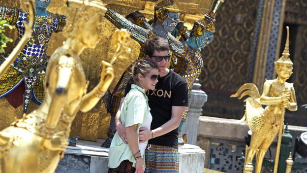 Tourists in Bangkok (Credit: Pornchai Kittiwongsakul/AFP/Getty)