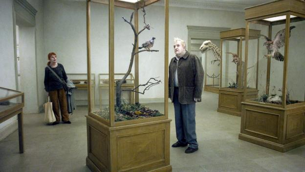 A Pigeon Sat On a Branch Reflecting On Existence (Roy Andersson Film Produktion)