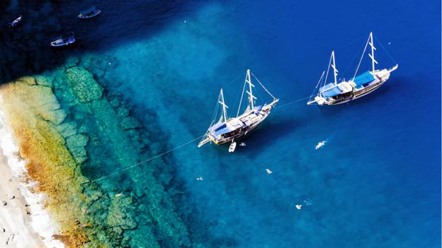 Gulet boats moor in the Mediterranean (Credit: Paul Biris/Getty)