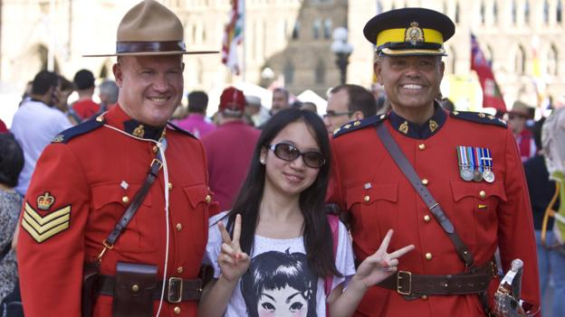 Royal Canadian Mounted Police on Canada Day (Credit: Credit: George Rose/Getty)