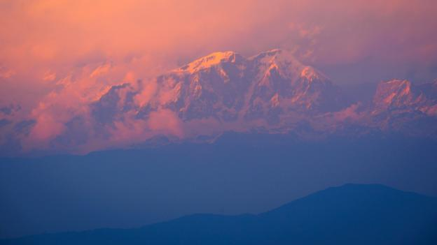 Pink sunset over Annapurna in Nepal (Credit: Credit: Whitworth Images/Getty)