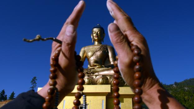 A devotee before the Buddha Dordenma statue in Thimphu (Credit: Credit: Prakesh Mathema/AFP/Getty)