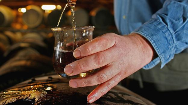 Taking a whisky sample from a cask at Bruichladdich (Credit: Credit: Jeff J Mitchell/Getty Images)