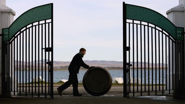 Pushing a barrel of Bruichladdich whisky (Credit: Credit: Jeff J Mitchell/Getty Images)