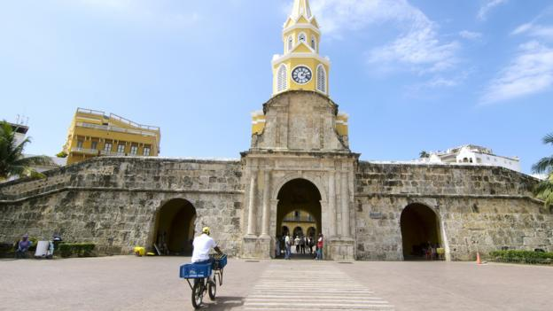 Bicycling through the Clock Tower in the walled city of Cartagena (Credit: Credit: Antonio Salinas L/Getty)