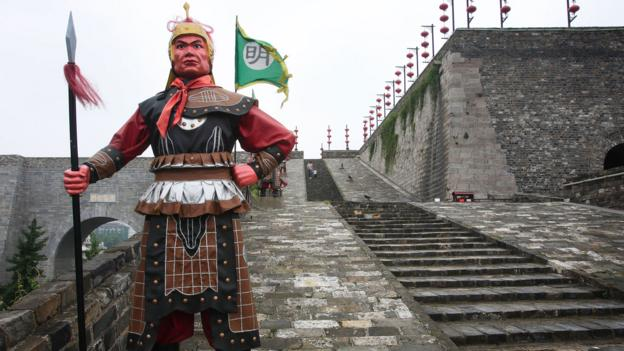 A warrior sculpture stands atop the Zhonghua Gate (Credit: Credit: China Photos/Getty)