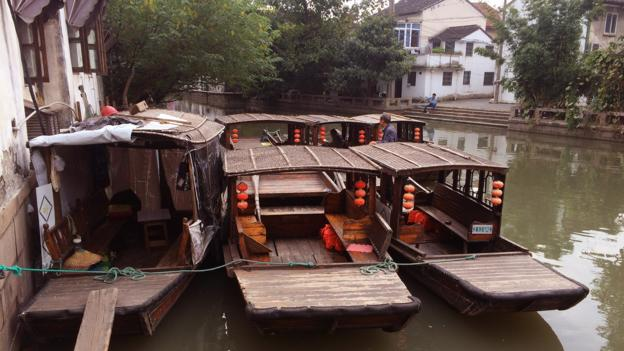 Visitors can enjoy a boat ride through Suzhou's canals (Credit: Credit: Eva Rammeloo)