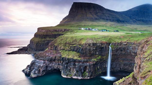Vagar Island is full of dramatic lakes, waterfalls and cliffs (Credit: Credit: Adam Burtn/Alamy)