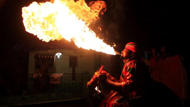 A fire breather lights up the night and dazzles the crowd (Credit: Credit: Dinodia Photos/Alamy)