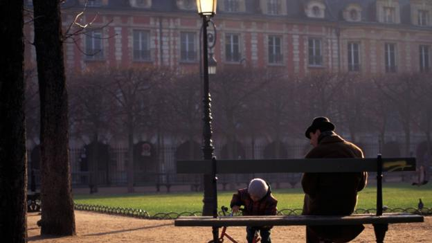 A father and son play in Place des Vosges (Credit: Credit: Jochem Wijnands/Horizons WWP/TRVL/Alamy)