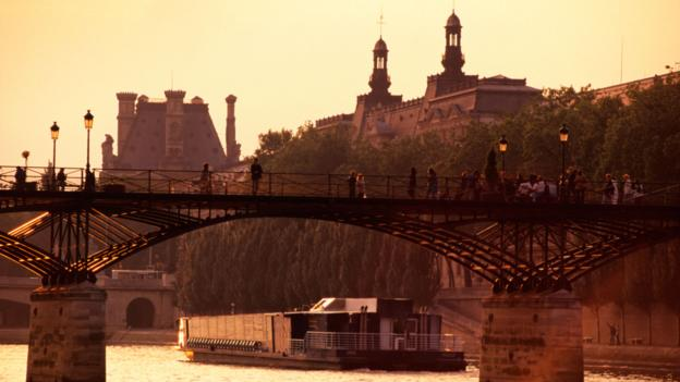 A bridge over the Seine (Credit: Credit: D Degnan/ClassicStock/Alamy)