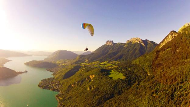 Paragliding in Annecy, France, with views of the French Alps (Credit: Credit: Aileen Adalid)