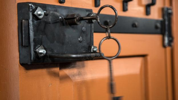 Clunky iron locks are still fixed to cell block doors (Credit: Credit: Alexander Aksakov/Getty)