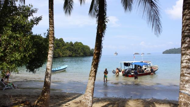 A dive boat arrives at the ranger station on Isla de Coiba (Credit: Credit: Sarah Shearman)