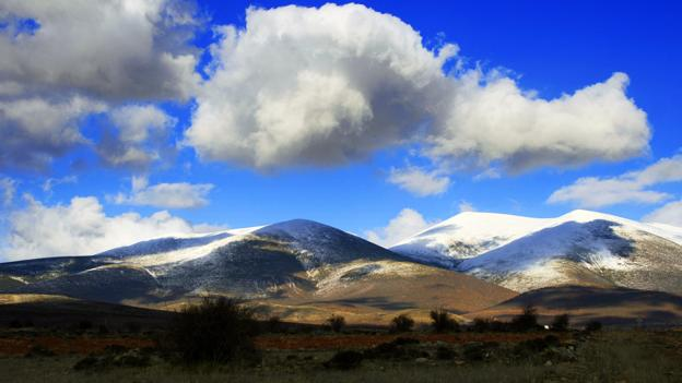 The village of Trasmoz is surrounded the snow-capped Moncayo mountains (Credit: Credit: Miguel Ángel García/Flickr)