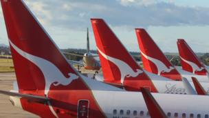 Australian airline Qantas sees its credit rating downgraded to below-investment level, or junk, by the ratings agency Standard & Poor's.